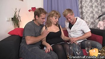 Busty mommy loves swallowing two cocks