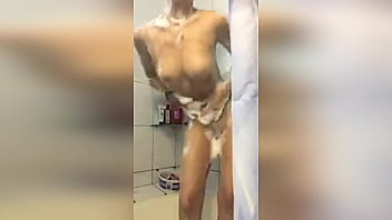 A girl from Russia takes a camera phone in the bathroom