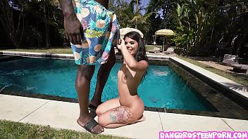 Tiny brunette teen sucks a black giant cock