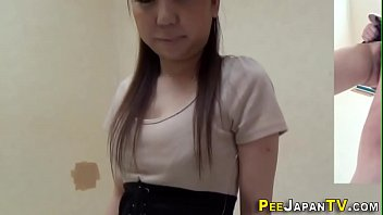Asian babe with big hairy bush pees