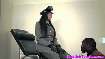 Uniformed mistress whipping black sub