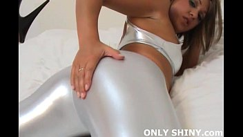 Girl next door Renee in shiny silver PVC panties