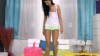Petite teen babe rolling in her own pee 8 min