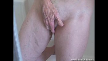 Super sexy old spunker feeling horny in the shower preview image