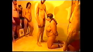 Sex Slave Suzisoumise offered in chains for twelve men to fuck.