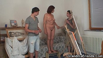 Two young painters bang granny