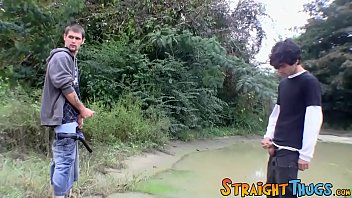 Two straight guys are wanking outdoors and competing for cum