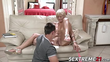 Horny granny enjoys riding and sucking big young dick porn image