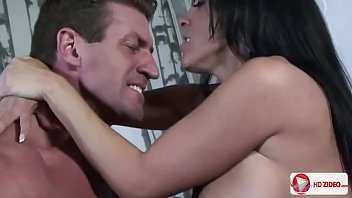 Sexy brunette with large buffers actively serving man