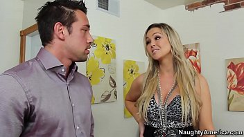 Naughty America Abbey Brooks fucking in the living room with her tits