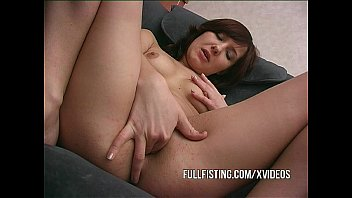 Petite Girl Takes Whole Fist Into Her Pussy