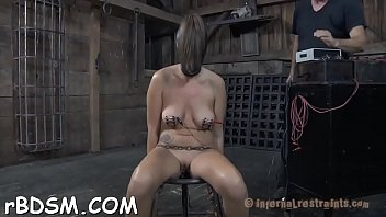 Clamped up hotty gets her fuck holes tortured