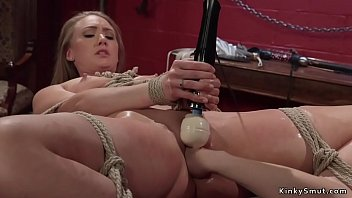 Busty lesbian whips and fucks slave
