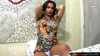 Raven haired shedoll with big lips jerks off her shemeat