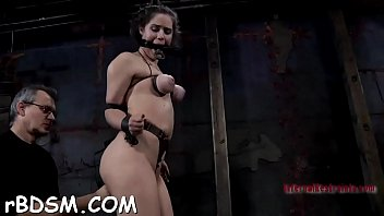 Chained up playgirl is punished