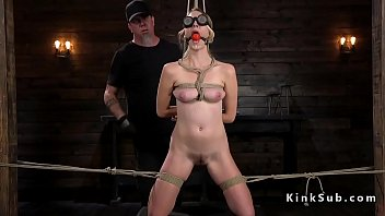 Hogtied blonde made to squirt