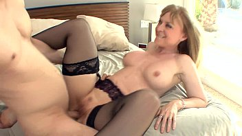 Big boobed blonde milf in stockings and a garter thumbnail