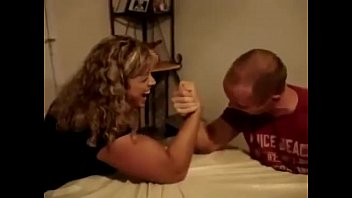 Arm workout Big Blonde Girl with huge thick biceps Armwrestling a man FBB Armwrestling
