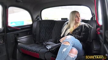Blonde woman tries cowgirl position inside the taxi