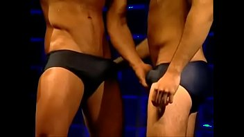 Swimmers Teasing and Worship each other bulges in speedo (sunga)