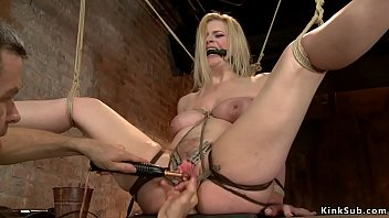 Gagged blonde slave is vibrated