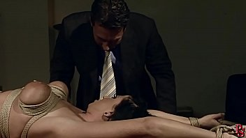 Gorgeous busty milf Andy Moon, tied and dominated by her boss. BDSM bondage sex movie. 16 min