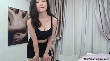 Busty petite Asian posing on cam