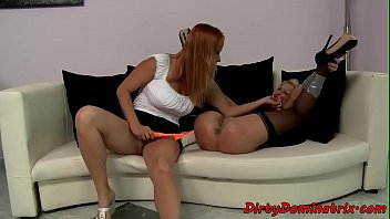 Maid dominating mistress with dildo