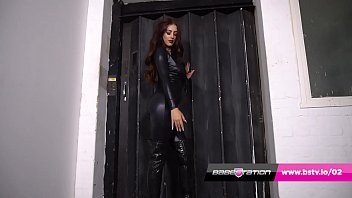 Delia Rose in latex catsuit & boots reveals her HUGE tits