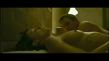 Mainstream sex and nudity from the movie The Girl With The Dragon Tattoo.  Forced blowjob (non explicit), tied down on bed, lesbian sex, non graphic fucking.