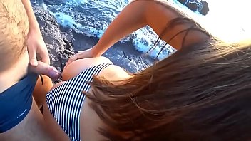 Husband bent his wife and fucked from behind by the sea