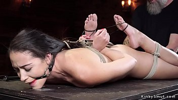 Slave in traditional hogtie is hooked