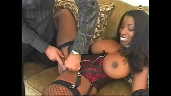 A white stud is fucking a busty ebony Vanessa Blue on the couch