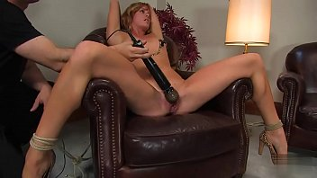 Gorgeous girl tied to the armchair and forced to enjoy