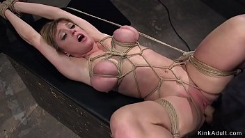 Busty Milf in tight bondage group fucked