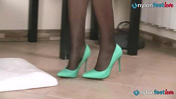 Sexy lesbians in a shoestore enjoy their feet in stockings
