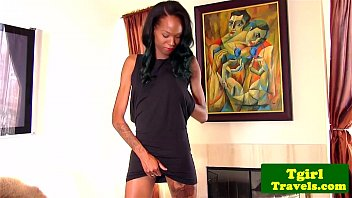 Tattooed ebony shemale assplays with toy