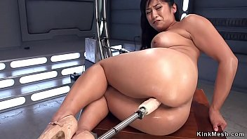 Busty dark haired Asian solo beauty takes fucking machine up her perfect ass