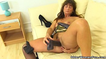 English milf Lelani gets busy with two giant dildos