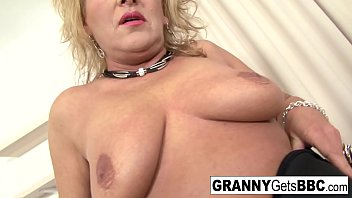 Granny in stockings teases the camera before interracial action