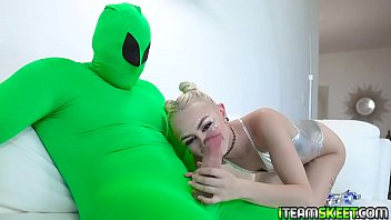 Chloe Temple rubs and caresses the aliens huge cock and wrpas her lips around it