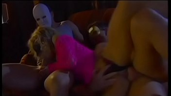 Curious blonde hottie in pink fishet outfit Justine Ashley came to masquerade ball and had to go the limit with couple of strangers to get access to secret information