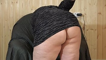 Beautiful BBW in a short dress masturbates in an armchair. Big rubber dick fucks her hairy pussy. Amateur fetish.