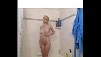 beautiful blonde taking a shower with cute tits