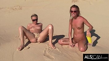 Pissing on the nude beach Six horny lesbians go at it on a public beach