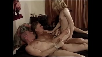 Shemale gets it in the ass while she is blowing another guy