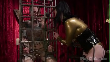 Kinky brunette uses strapon to fuck her slave