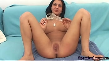 Speculum babe spreads her pussy lips and pisses in cup