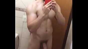 Bearded Hunk showing thick flacid dick on the mirror