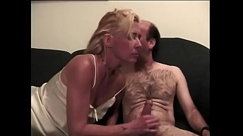 Dude shoves his long tool inside blonde MILF's throat on the couch